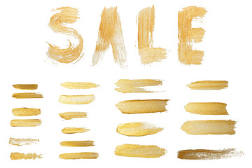 illustration of gold colored acrylic paint hand lettering sale and smear set isolated on white...