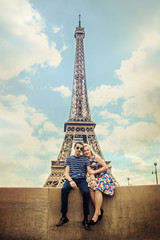 Lovers in the Eiffel Tower. Selective focus.