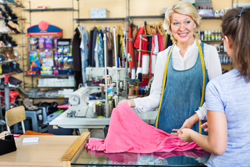 Woman tailor taking order from customer