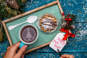 New Year's photo of tea with image of fir, cake