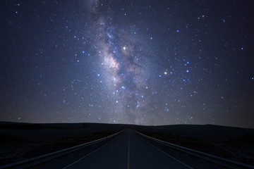 The milky way galaxy over the road with stars and space dust in the universe