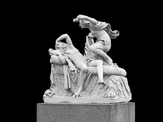 Cupid and Psyche - sculptural group on a black background. Summer garden in St. Petersburg