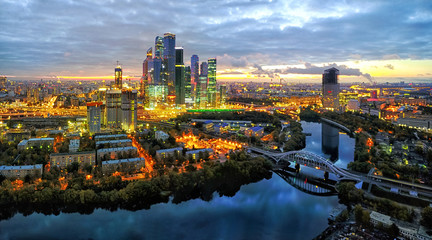 Moscow City district and Moscow river at dusk, aerial view