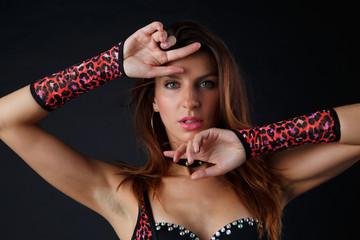 Portrait of sexy woman in red underwear, gloves
