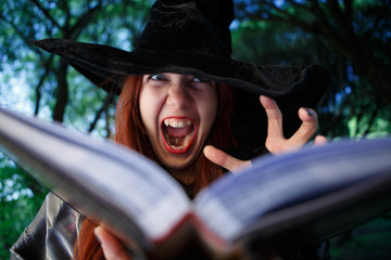 Close-up photo of witch reading spell