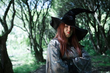 Photo of dissatisfied witch in long black hat
