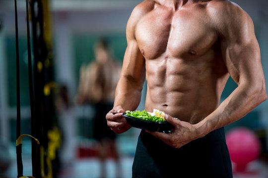 guy eating salad gym fitness