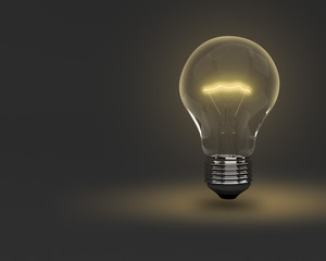 Light bulb in the dark concept background