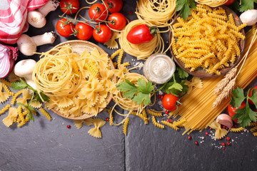 assorted raw pasta and spices