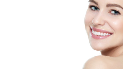 Beautiful young blond smiling woman with clean skin, natural make-up and perfect white teeth white background