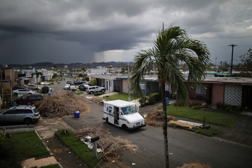A U.S. Postal Service truck is seen at an area damaged by Hurricane Maria in San Juan, Puerto Rico