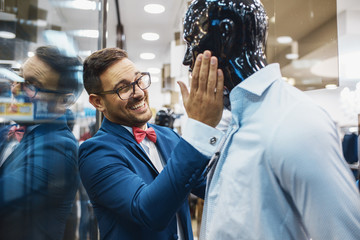 Smiling Young Man Buying Clothes