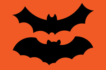 Set of flying bat silhouettes isolated on orange background. Vector illustration.