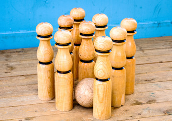 old wooden bowling pins