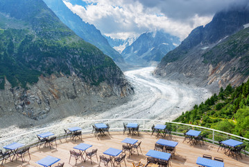Panoramic cafe terrace with view on glacier Mer de Glace, in Chamonix Mont Blanc Massif, The Alps, France