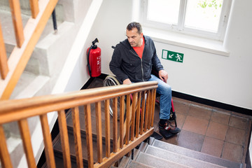 Man In Wheelchair Stuck On The Stairs