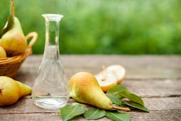 Pear brandy in bottle with pears