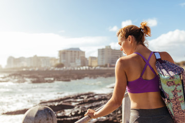 Relaxed woman at seaside after her workout