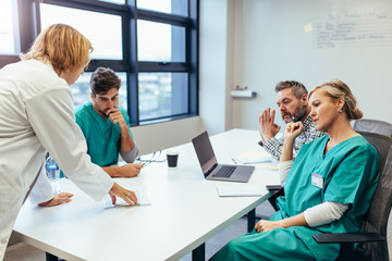 Group of medical professionals brainstorming in meeting