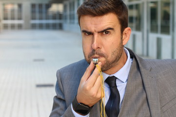 Businessman blowing a white isolated