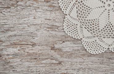 Vintage lace fabric border on wooden background