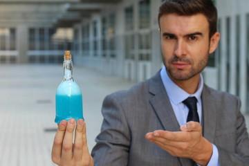 Handsome businessman holding a potion
