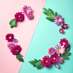 Circle frame of autumn flowers - chrysantemum and asters, on two-coloured background