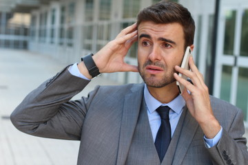 Businessman crying on the phone