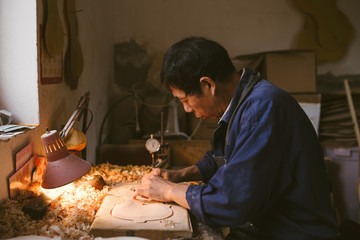Violin maker at work