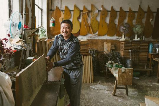 Violin maker at work