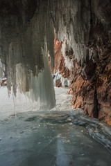 Door stickers Gray A view from the ice cave, with long icicles, in Olkhon island, lake Baikal,Siberia,Russia.