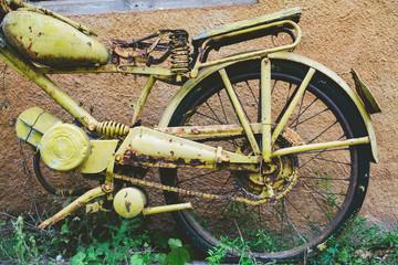 Old yellow motor bike.