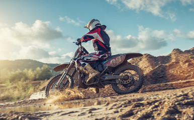 Enduro Extreme Motocross MX rider in Action on a dirt track