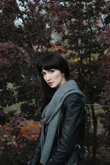 Portrait of a young woman near bush