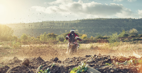 motocross MX Safari motorcycle on a dirt track with beautiful landscape
