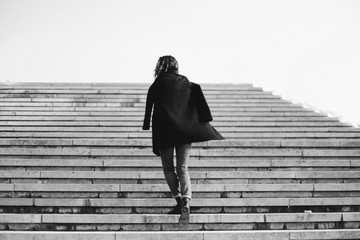 Young woman on the stairs