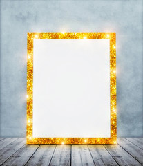 Empty golden glitter frame in room with blue wall and wooden floor