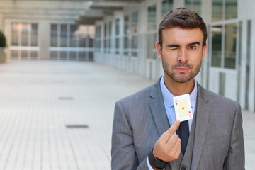 Businessman showing the ace of hearts