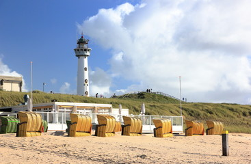 Lighthouse and beach in Egmond aan Zee. North Sea, the Netherlands.