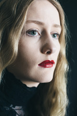 Teen girl with blonde hair and red lipstick