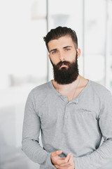 Handsome serious Asian man with a beard