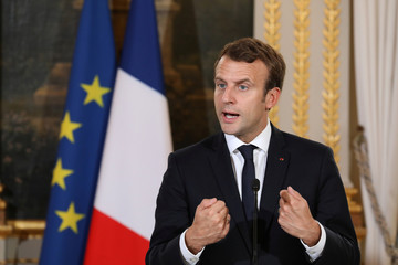 French President Emmanuel Macron reacts during a joint press conference with the UN High Commissioner for Refugees (UNHCR) following their meeting at the Elysee Palace in Paris