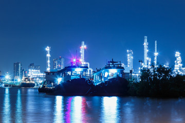 The lights from ship and Oil refinery with beautiful in night Bangkok