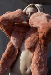 woman in orange fur coat