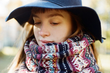 Close up portrait of a woman wrapped in a scarf