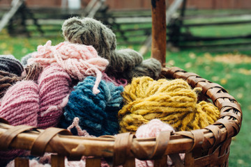 Colorful yarns of naturally dyed wool in a basket