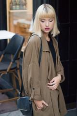 Portrait of a beautiful female model on the street