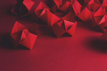 Folded red paper fortune tellers on red...