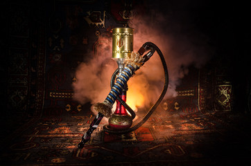 Hookah hot coals on shisha bowl with black background. Stylish oriental shisha. Shisha Concept. Copy space