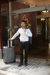 Businessman leaving hotel
